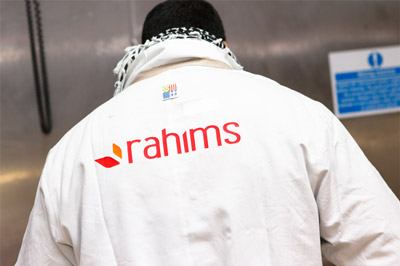 rahims careers, man standing with rahims logo on back